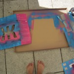 Spraypainting the boxes with stencils